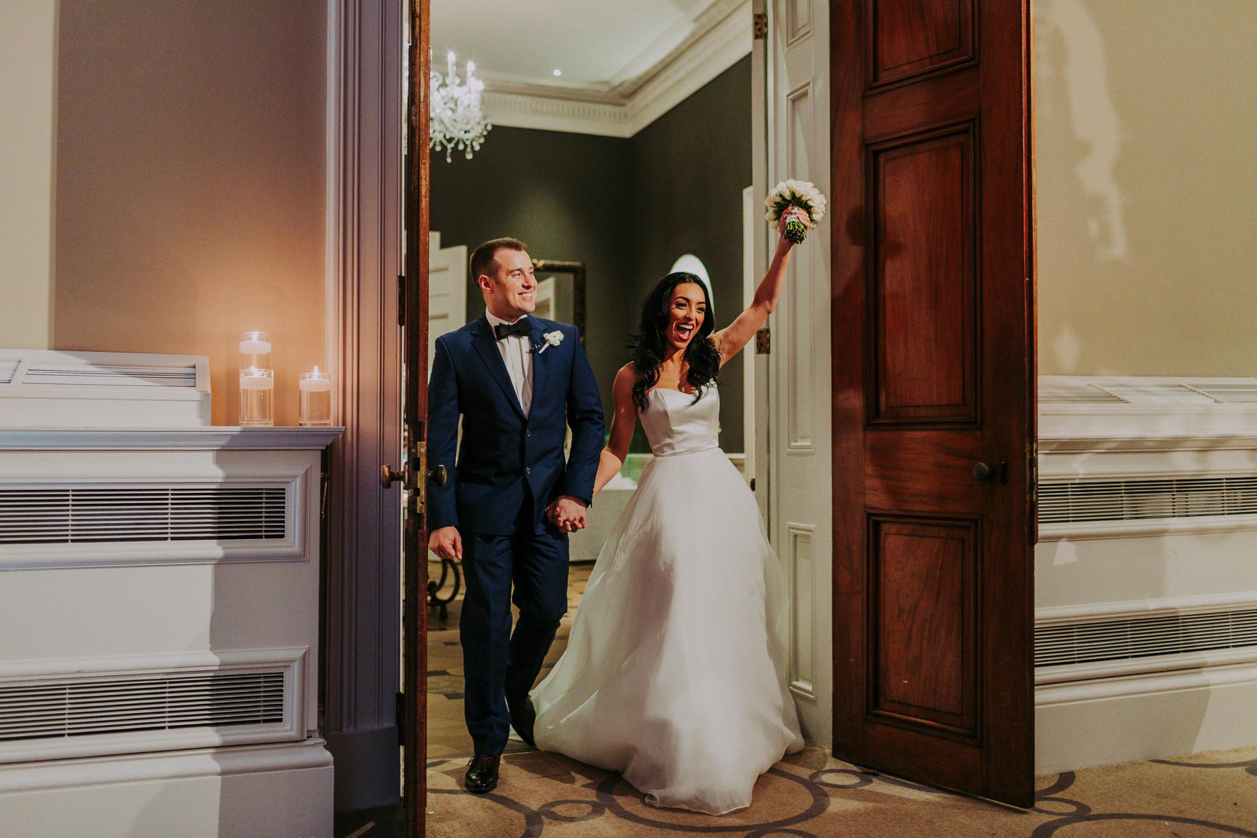bride and groom entering reception at Rudding Park Wedding