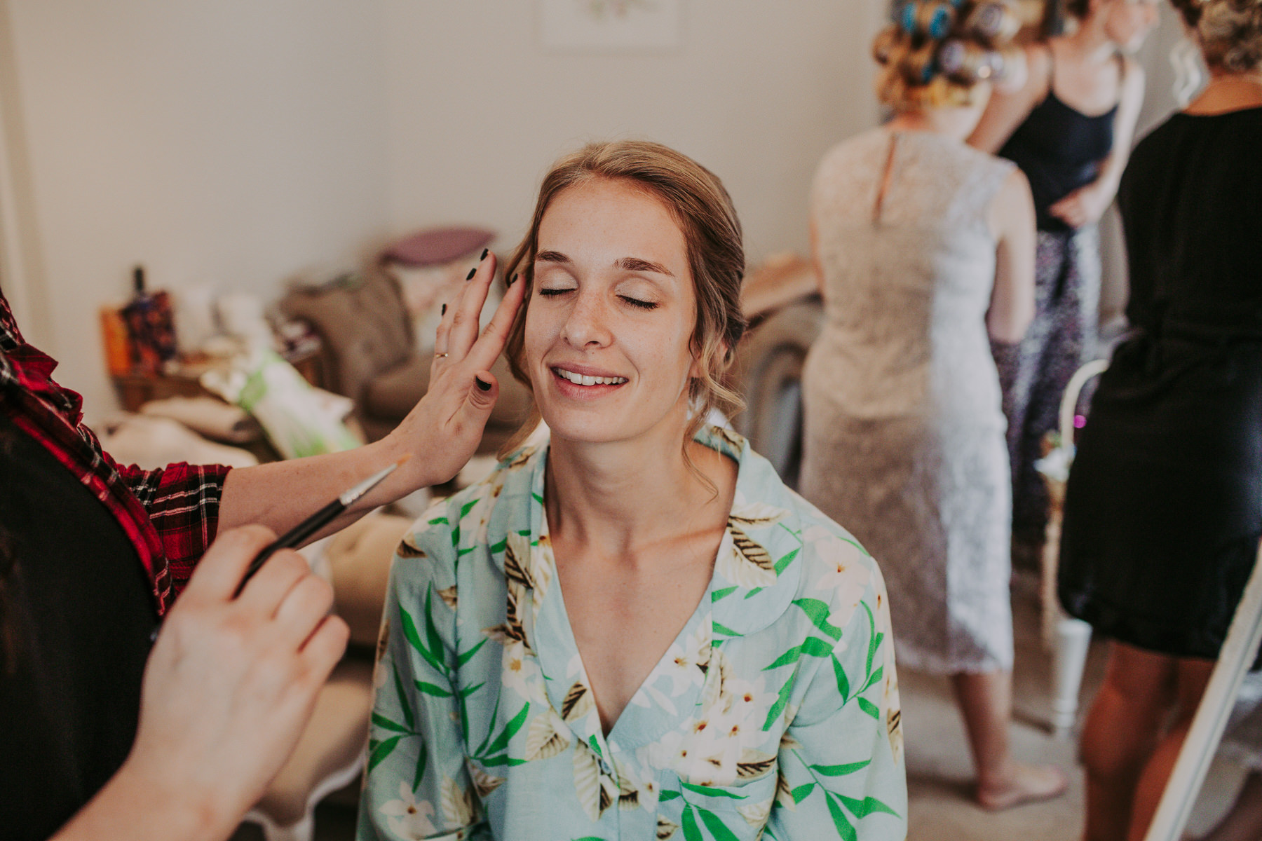 bride having makeup Sandhole Oak Barn Wedding