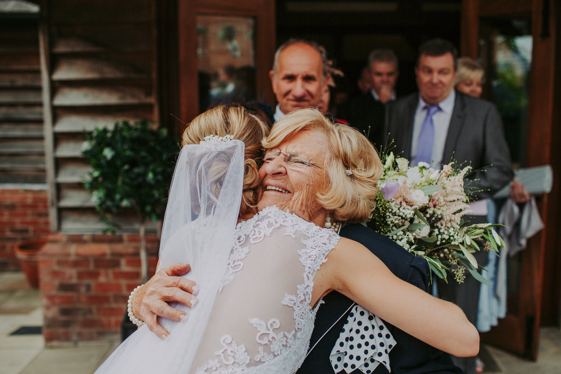 wedding guest hugging bride Sandhole Oak Barn Wedding