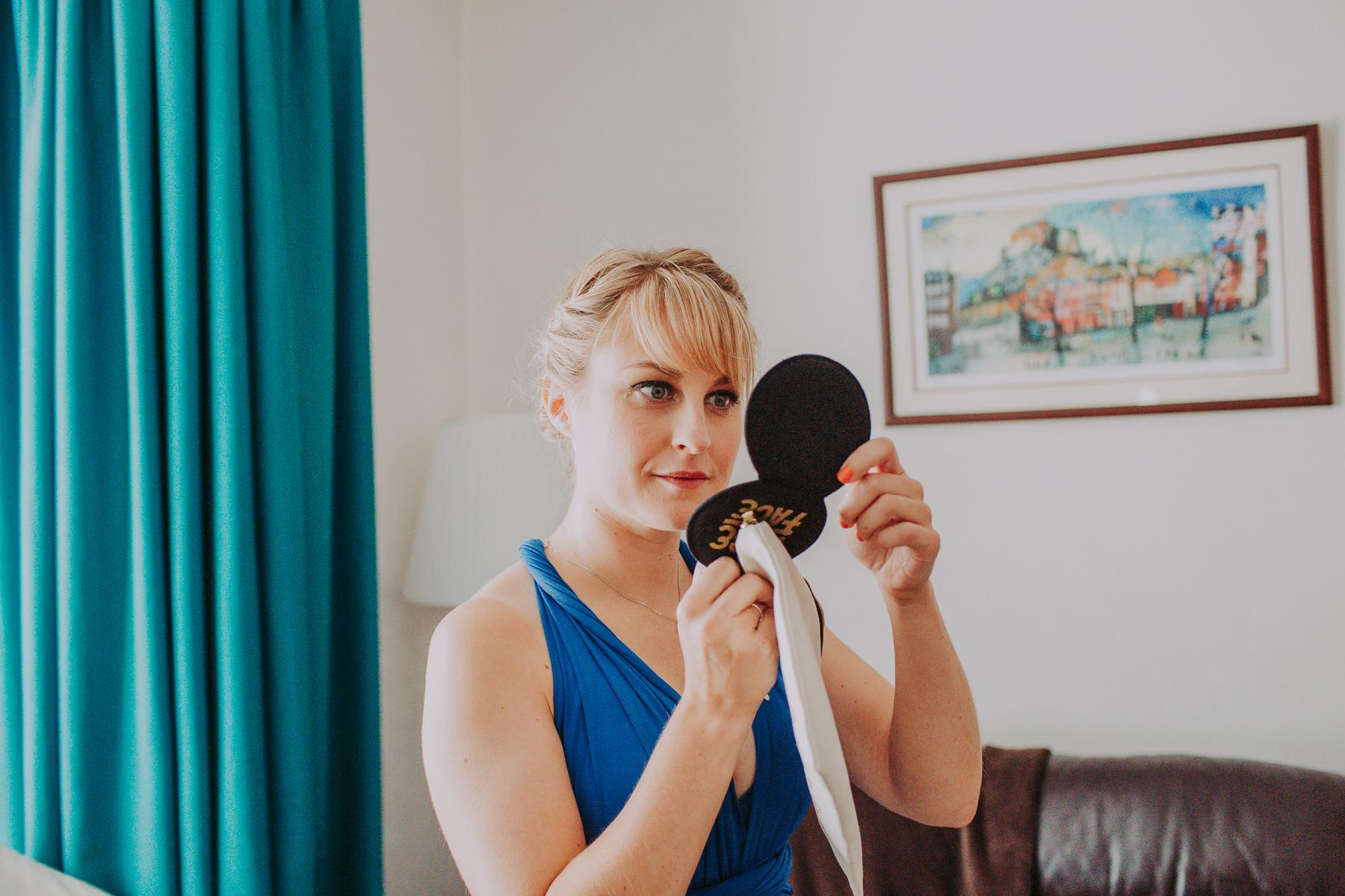 bridesmaid looking into mirror