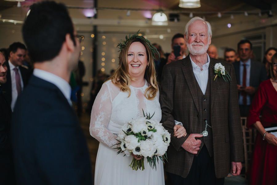 bride walking down aisle at natural retreats wedding