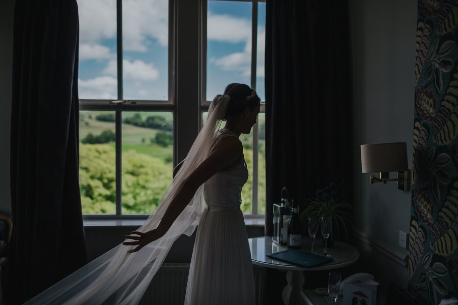 bride near to window at the devonshire fell wedding