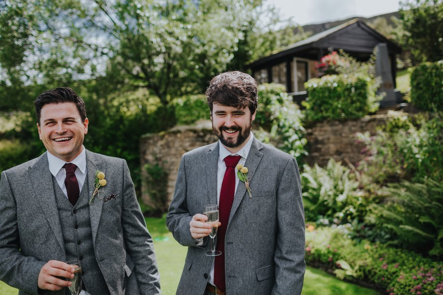 Groomsmen laughing at the devonshire fell